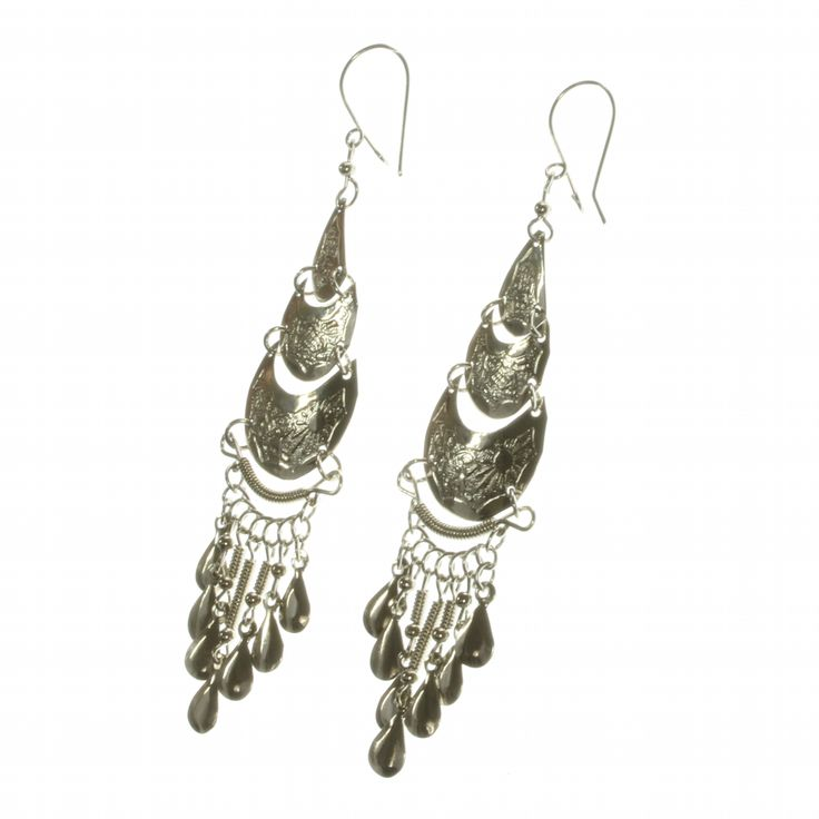 A striking alpaca silver drop earring based on a traditional Inca design on a shepherd's crook for pierced ears.  Delicately engraved, cascading plates finished with a twisted wire and teardrop fringe.  Only £8.99