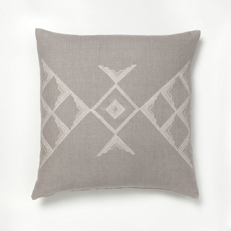 Intricate hand embroidered graphic design make this pillow cover a real work of art // more on ARTHA Collections #throwpillows #linenpillows #beigepillows
