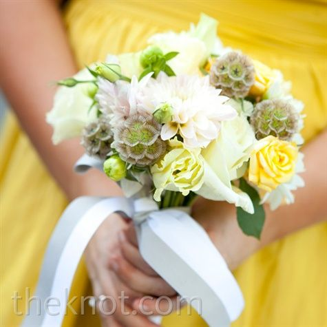 I like how simple it is and there is that pop of yellow - scabiosa pods and soft yellow roses