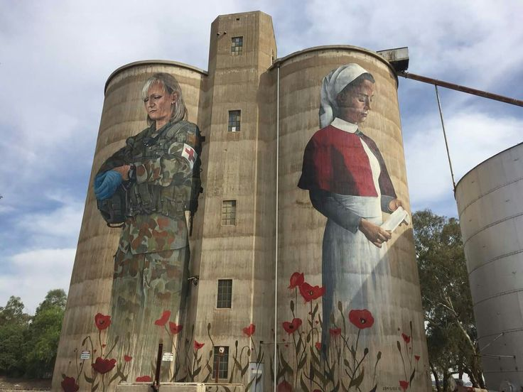 Silos painted for Anzac day - depicting two women, 100years apart.