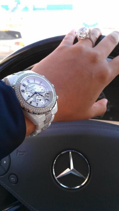 The watch. But let's take a moment to recognize the size of that diamond!! Wow!!