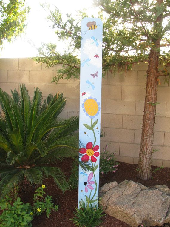 Whimsical Garden painted Fence Board...would be a fun place to show childrens heights as they grow along with the garden...