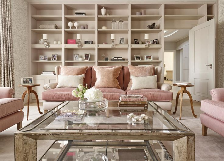 Soft pink sofas and mirrored furniture create a calm, feminine interior in this…