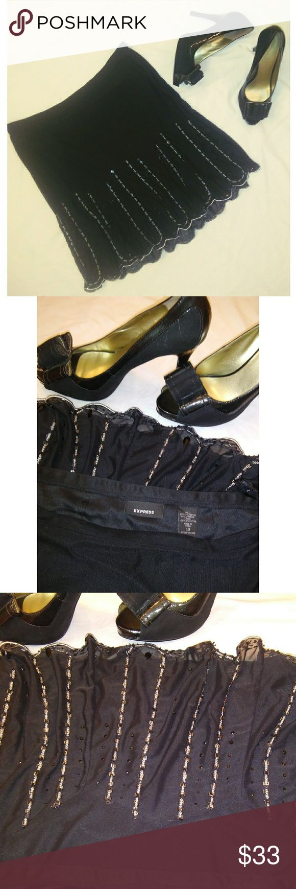 Stunning Express party skirt This amazing black Express skirt has beadwork and pleats in all the right places. Worn once and it was a great time for dancing! The Nine West heels in the picture are also available in my closet. Bundle bundle bundle Express Skirts