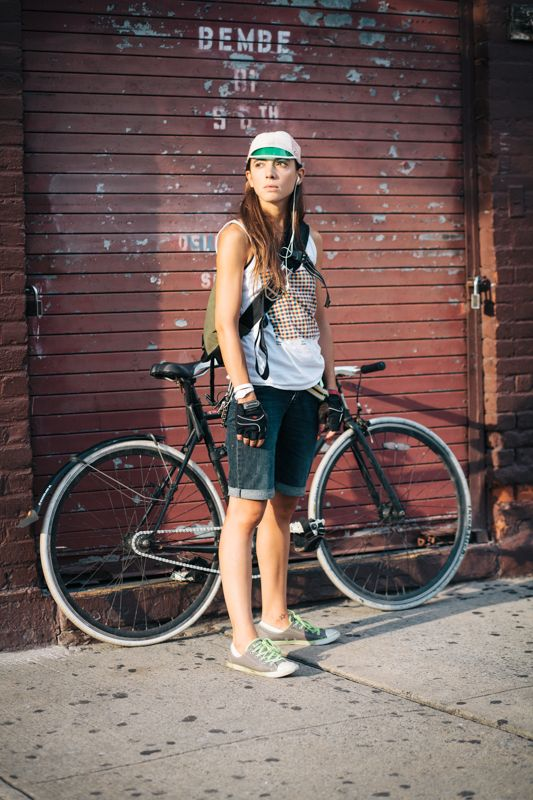 Isabelle rides a Specialized fixed gear bicycle photographed on S. 6th and Berry St., Brooklyn en route to East River Bar