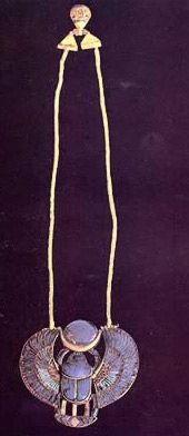Tut Exhibit - King Tutankhamun Exhibit, Collection: Jewelry - Necklace with Scarab with Falcon Wings Holding Infinity Symbol representing King Tutankhamun