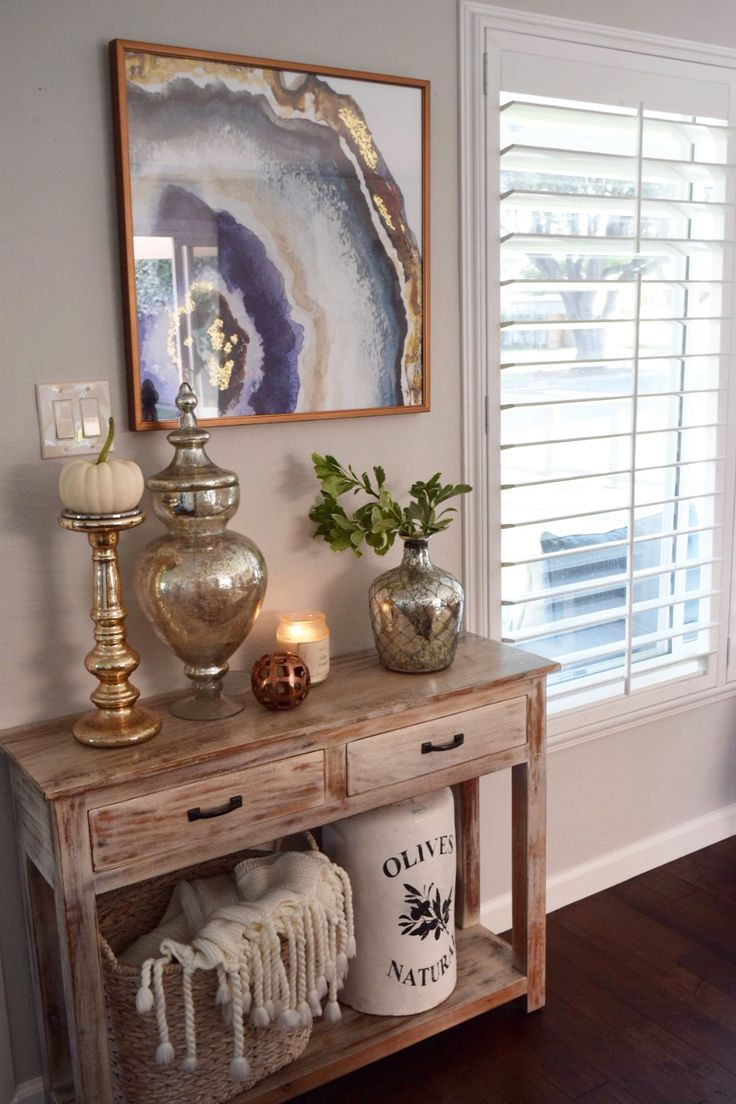 greet your guests at the entryway with an inviting console table dressed in fall decor