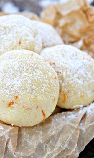Orange Vanilla Cookies-Packed with freshly grated orange zest and vanilla bean paste, these melt in your mouth Orange Vanilla Cookies are the perfect addition to your cookie tray or holiday cookie exchange party. Serve them this fall and winter - they make the perfect dessert for Thanksgiving and Christmas.  You're friends and family will beg you for the recipe for these unique sweet treats.