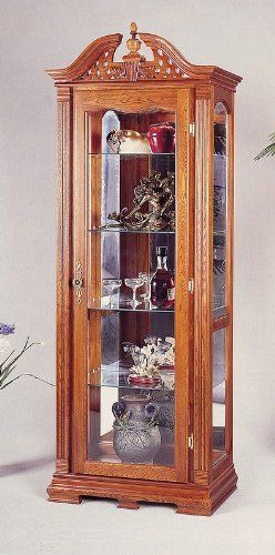 """Chippendale Style Solid Oak Wood Curio China Cabinet w/Interior Light by Coaster Home Furnishings. $434.20. Some assembly may be required. Please see product details.. Dining and Kitchen. 30""""L x 14 3/4""""W x 81""""H. Dining and Kitchen->China Cabinets. This Chippendal Style Curio Cabinet featuresglassstorage shelves, interior lighting, a classic chippendale style and is made of solid oak. Thisoak curio cabinet will fit nicely in any room andadd to a traditionaldecor. This discount..."""