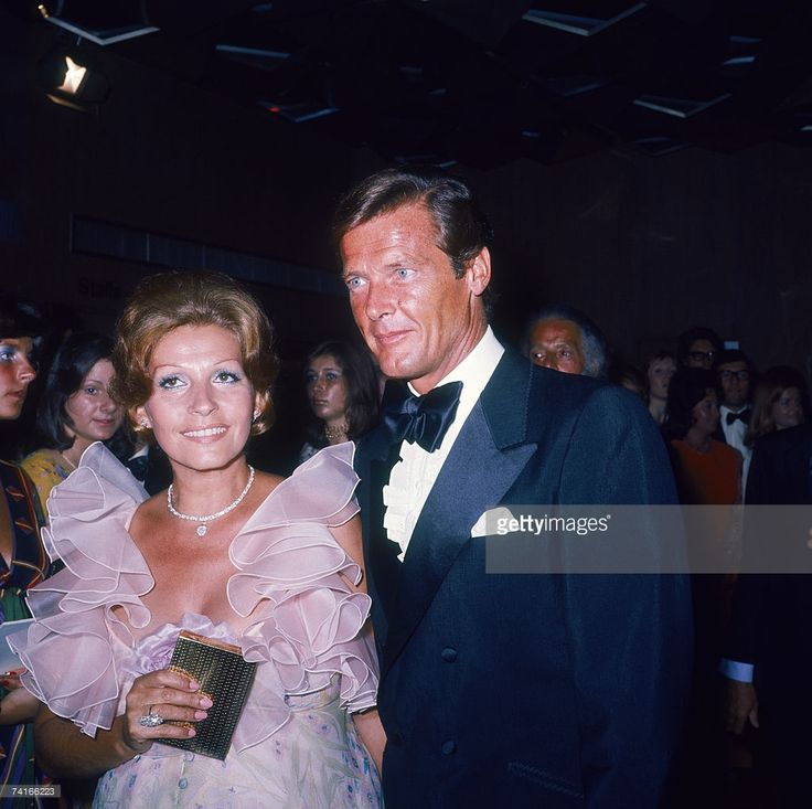 Roger Moore with his wife Luisa Mattioli at the premiere of the James Bond film 'Live and Let Die', directed by Guy Hamilton, London, 5th July 1973