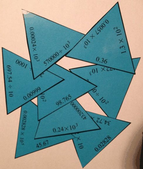Engaging Math: Tarsia Puzzle - Multiplying and Dividing by powers of 10