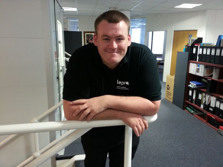 Welcome to Mark, our new office assistant, dutifully dressed in his new Lepra t-shirt.