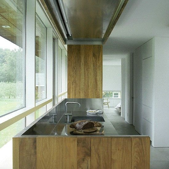 Wood and stainless steel are a magical pairing shown here with a stainless steel integrated sink and stylish Arne Jacobsen tap. http://www.housetohome.co.uk/kitchen/picture/contemporary-walnut-and-steel-kitchen-1#Lr0RROXl96siVE6A.32