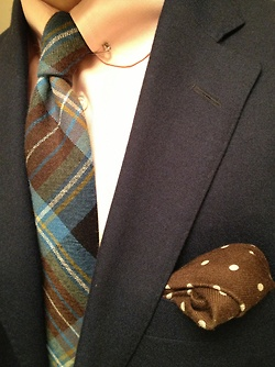 The so-called eyelet collar is worn with a collar bar. A rarely seen style that, if worn correctly, can boost your sartorial credibility. Nicely paired with wool plaid tie and polka dot pocket square...