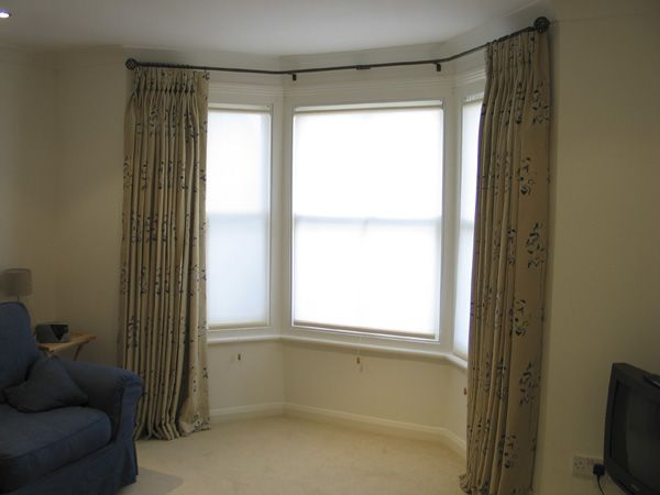 Bay Window Curtains Gallery | Roller blinds for privacy together with  curtains on a bay window