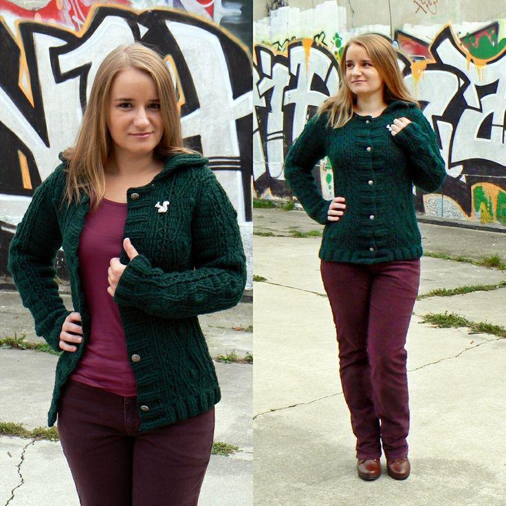 Dark green crochet sweater with pattern imitation aran knitting.