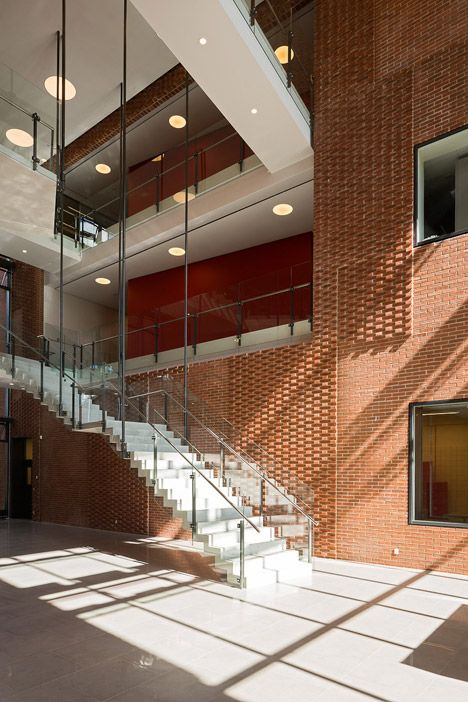 Prefabricated brick panels create decorative cladding for this meat research facility.