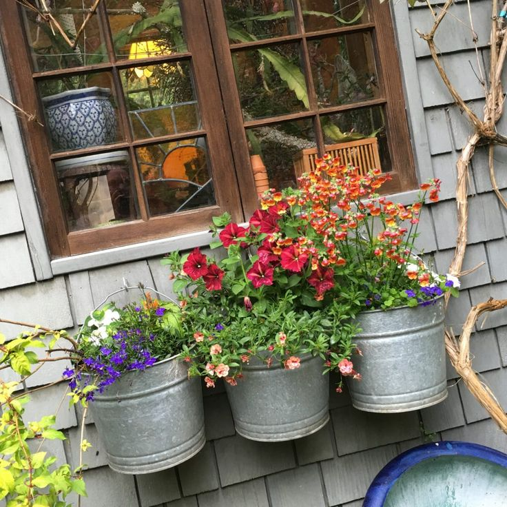 Bucket Planters ~ An adorable potting shed for gardening... tour on montanahappy.com