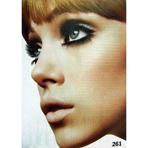 60s inspired makeup.  nude lips, dark eyes.
