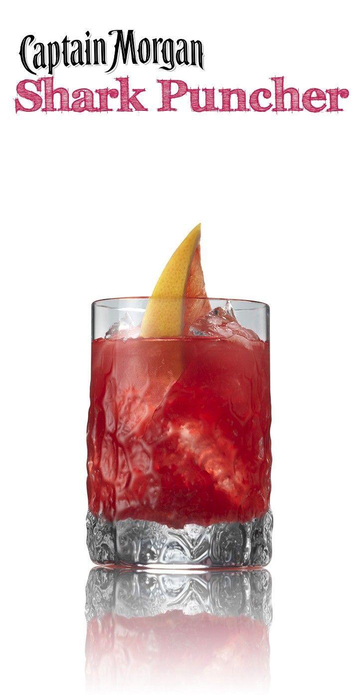 Shark Puncher - coconut rum, orange juice, grapefruit juice, and cranberry juice! LOVE this drink recipe! #cocktailrecipes