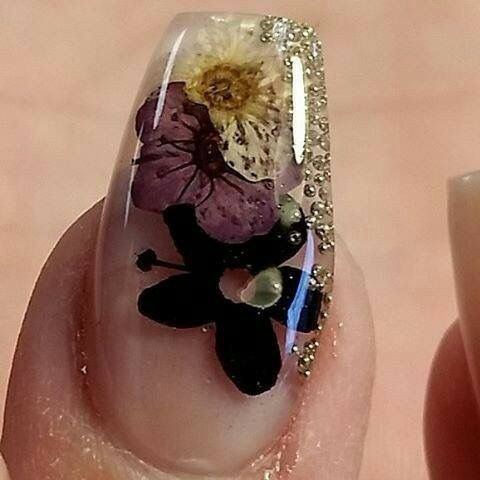I love clear nail designs as they almost look like glass sculptures. Adding floral to a clear nail gives it such a pretty and delicate look - love it!