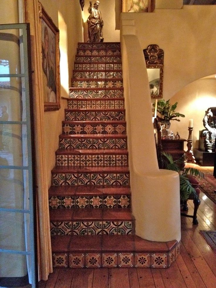 Tiled stair risers with terracotta stair runs.