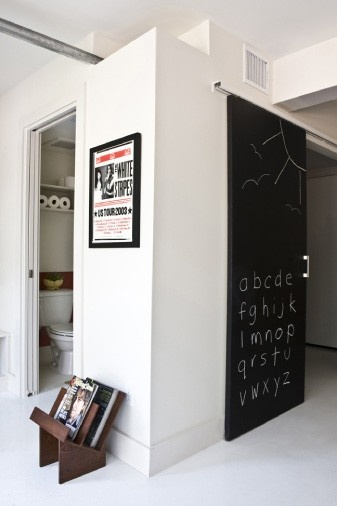 Awesome Sliding Barn Door with chalkboard paint.