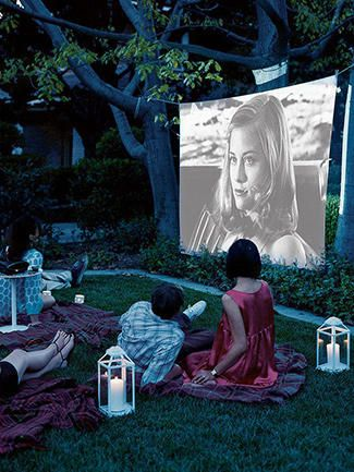 10 Unforgettable Summer Party Ideas: Rent a screen and projector, toss some pillows and blankets around the yard and just chill out with your pals.