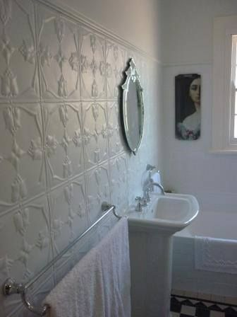 Tulip pressed tin panel as bathroom feature wall. www.icotraders.co.nz