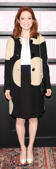 Who made Ellie Kemper's bow dress, tan dot coat, and black handbag?