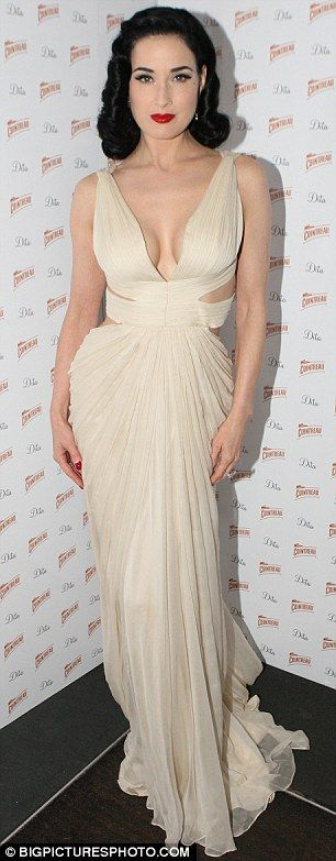 2/2 Retro glamour: Dita Von Teese looked stunning in her revealing gown, which featured a low back and plunging front and back
