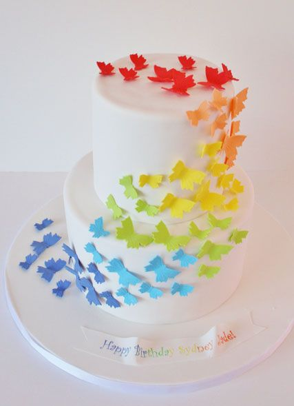 Rainbow Butterfly Custom Cakes. This is a difficult design to make, despite it's apparent simplicity. The white icing has to be flawless, and each butterfly perfect. I am in awe.