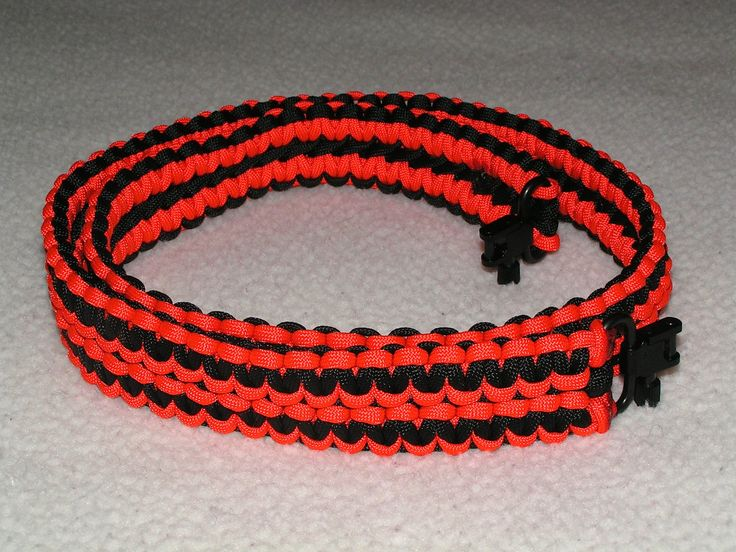 """PS05 - A Double Cobra Stitch Gun Sling, made of """"Black"""" and """"Neon Orange"""" with Blued (Black), Spin button style swivels. - pinned by pin4etsy.com"""