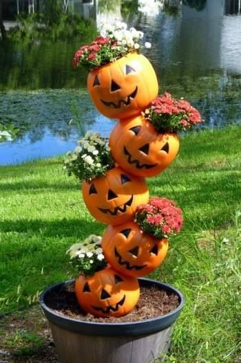 Fill the plastic pumpkins with fall flowers.: