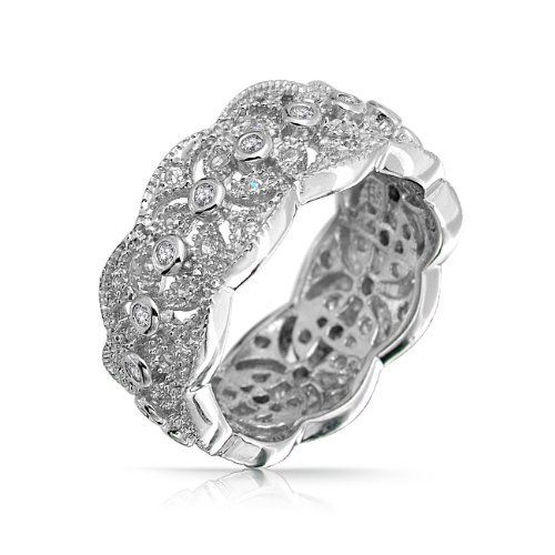 Bling Jewelry Sterling Silver CZ Vintage Four Leaf Band Ring Bling Jewelry. $59.99. Four leaf motif, Bezel and Pave set cubic zirconias. Vintage band ring. Weighs about 6 grams. Rhodium plated sterling silver. Band width is 9mm