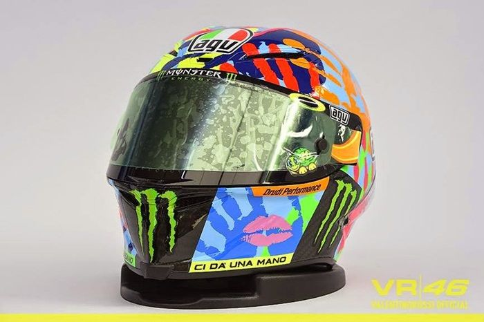 Valentino Rossi 'Give Us A Hand' Helmet (Misano): Valentino Rossi had the 'power of many' for the Misano MotoGP as he raced with a helmet that had the hand-prints from his mechanics and family printed on it. This helmet also featured the thumbprint of Aldo Drudi – Valentino's long time helmet designer.  Rossi won the race taking his 82nd victory in the premier class.