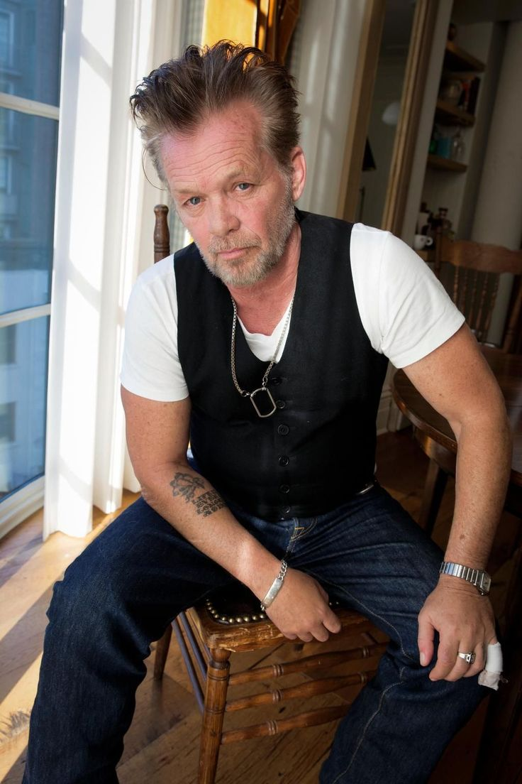 John Mellencamp feels he has some impressive co-writers for his latest songs, like playwright Tennessee Williams and folk legend Pete Seeger.