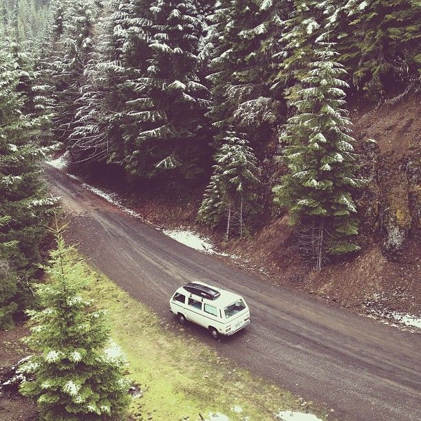 VW van on a wintery forest road
