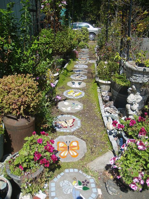 garden paths and stepping stones. i want a path of mosaic stepping stones in my garden someday. love the butterflies paths and