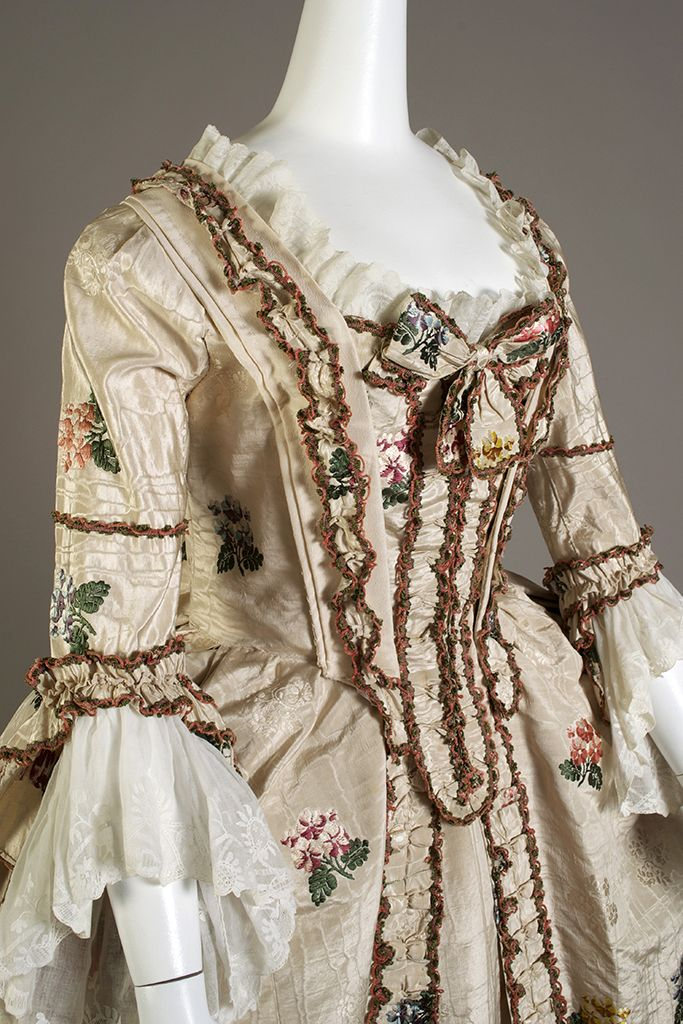 Open robe, stomacher and petticoat of ivory silk moiré brocaded with sprays of multicolored flowers, English, ca. 1765, KSUM 1983.1.24 a-c.
