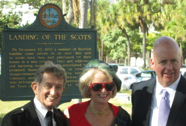 Fomer SCAS President Bill Wallace, current SCAS President Beth Ruyle Hullinger at ceremony conducted Dec. 6, 2013 by Sarasota Mayor Shannon Snyder and members of the Caledonia Club of West Florida & Sister Cities Assn of Sarasota at the point of landing in 1885 of the Scot founders of the City of Sarasota
