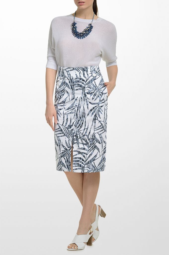 Sarah Lawrence - short sleeve knitted blouse with lurex, printed skirt, beaded necklace.