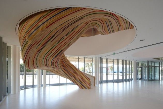 Tétrarc Architects designed these sculptural stairs at the School of Arts in Saint Herblain, France.