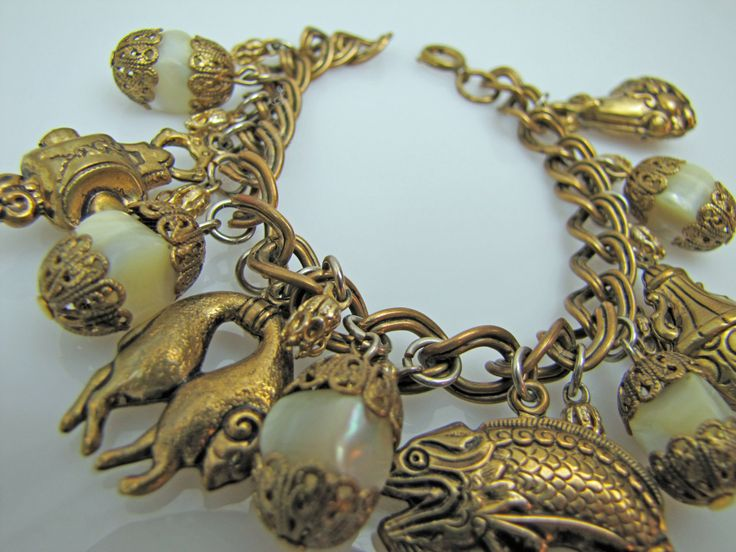 Vintage 1950s Miriam Haskell Chunky Charm Bracelet. Antique Gold. Oriental Etruscan Design Fish Wine Cask Rams Filigree Pearl Charms by MercyMadge