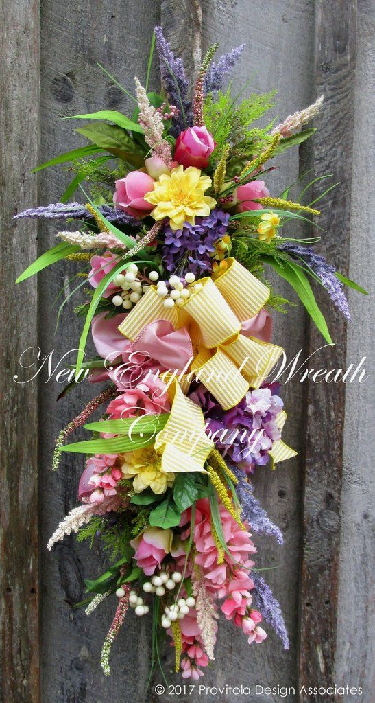 Elegant Spring Garden Swag. A gorgeous bouquet of Roses, Lilacs, Wisteria, Hydrangea and other romantic garden favorites in soft pink, lilac and buttery yellow create this stunning swag, accented by l