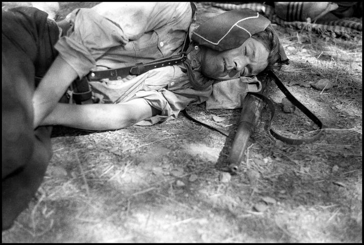 Spain - 1936. - GC - Robert Capa - August 1936. Republican soldier resting after two days of battle.