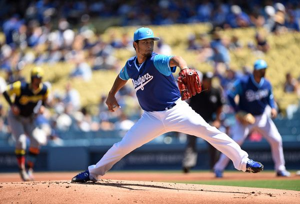 Yu Darvish Photos Photos - Pitcher Yu Darvish #21 of the Los Angeles Dodgers throws against the Milwaukee Brewers during the first inning at Dodgers Stadium August 27, 2017, in Los Angeles, California. - Milwaukee Brewers v Los Angeles Dodgers