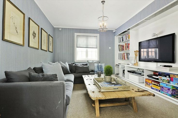 My TV room walls are a similar color and I just ordered a sectional in a similar color to what's shown here.