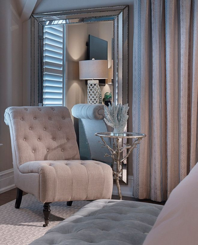 In a corner of the master bedroom a shingle chair and small side table adds comfort to the Master bedroom chair rail