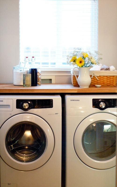 Use an Ikea butcher block countertop above your washer and dryer for a pretty work surface.